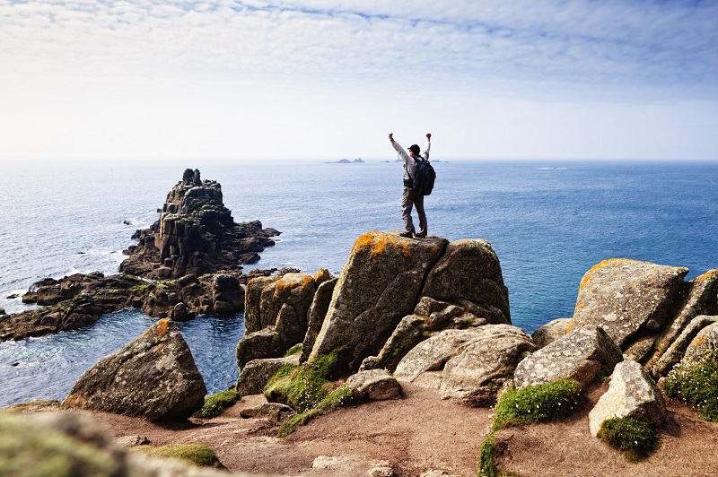 Happy hiker at Lands End, Cornwall
