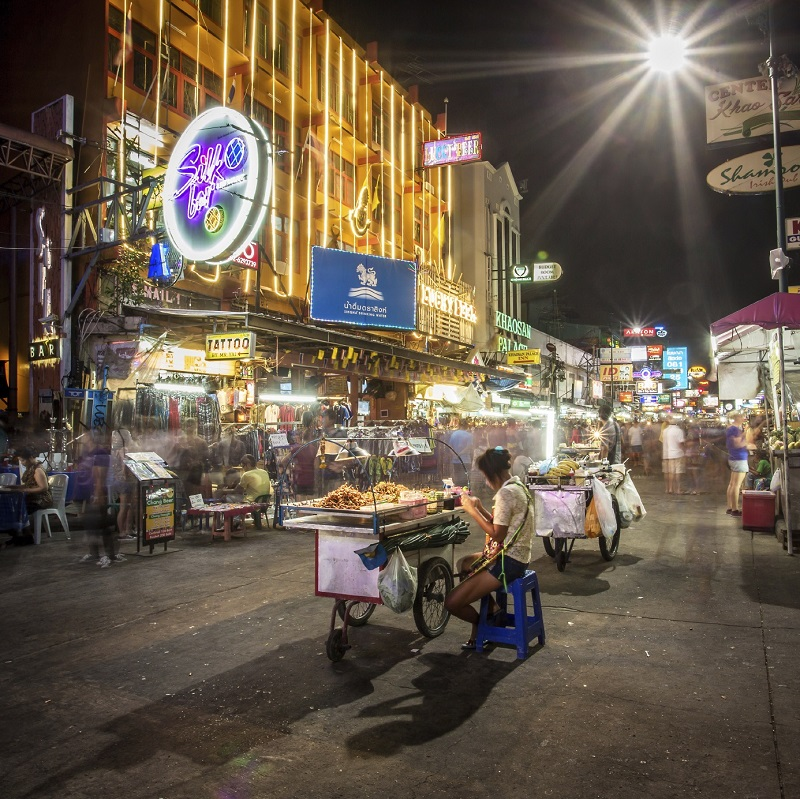 BANGKOK - APRIL 21, 2014: Street food vendor and tourist shops on Khao San Road on April 21, 2014 in Bangkok, Thailand. Khao San Road is a famous low budget hotels and guesthouses area in Bangkok.
