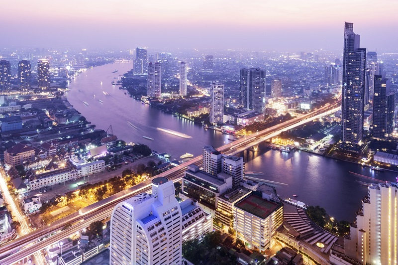 Aerial view of the Bangkok city skyline and the Chao Phraya River, Thailand.