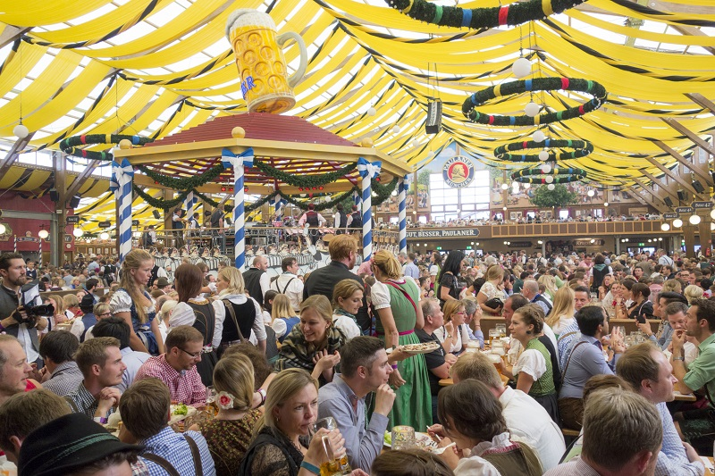 Munich, Germany - September 20, 2015: Many People are sitting in the beer tent at the Octoberfest in Munich and having fun.The Oktoberfest is the largest fair in the world and is held annually in Munich.