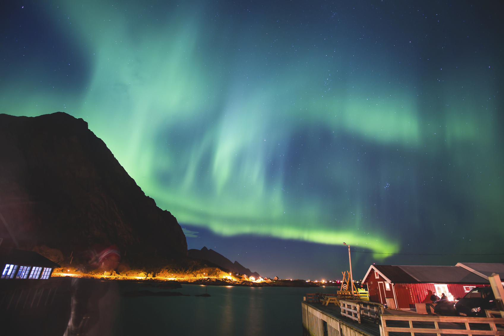 Beautiful picture of massive multicoloured vibrant Aurora Borealis, Aurora Polaris, Polar Light, also know as Northern Lights in the night sky over Norway, Lofoten Islands