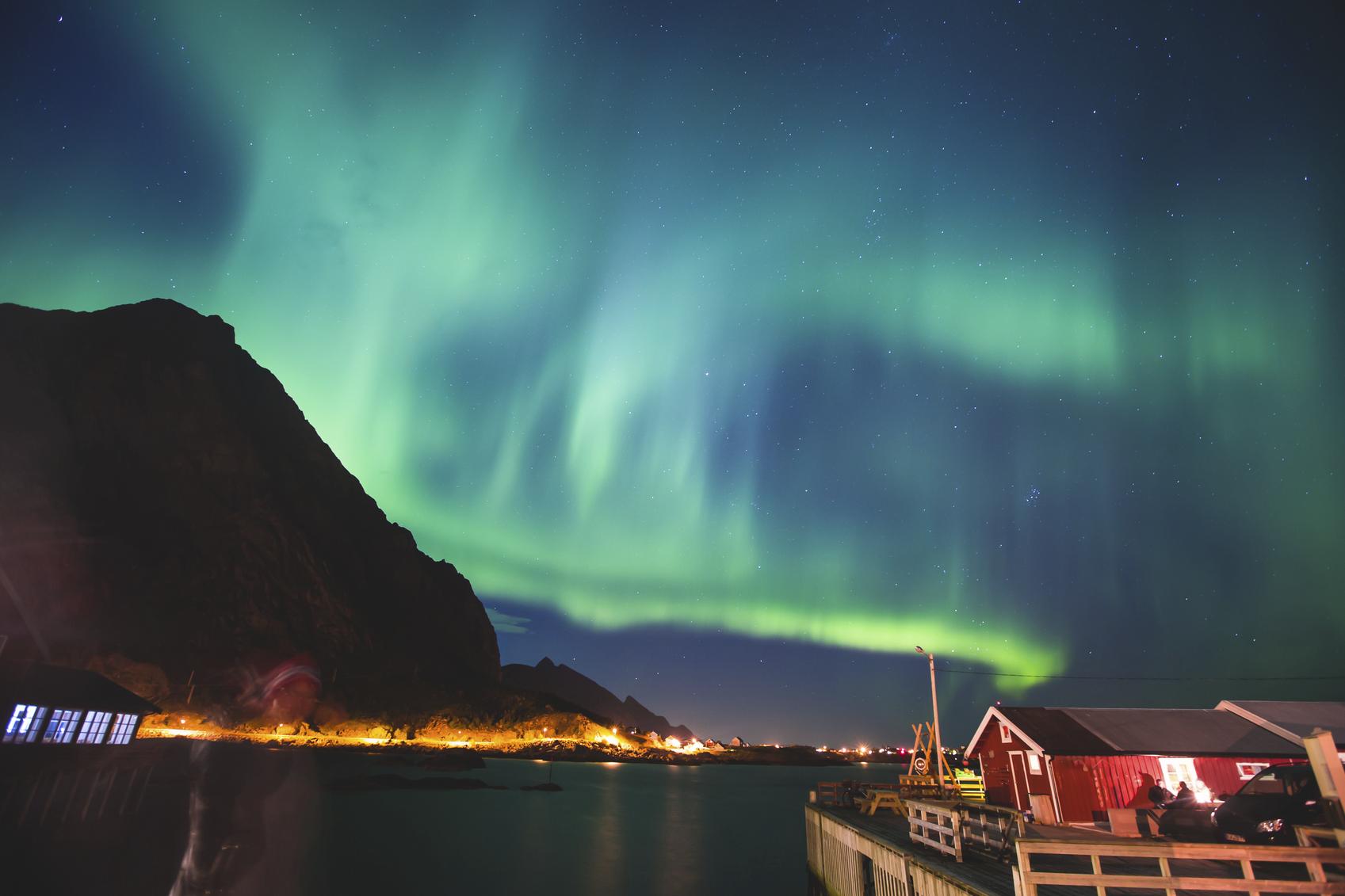 Beautiful picture of massive multicoloured vibrant Aurora Borealis, Aurora Polaris, Polar Light, also know as Northern Lights in the night sky over Norway, Lofoten Islands