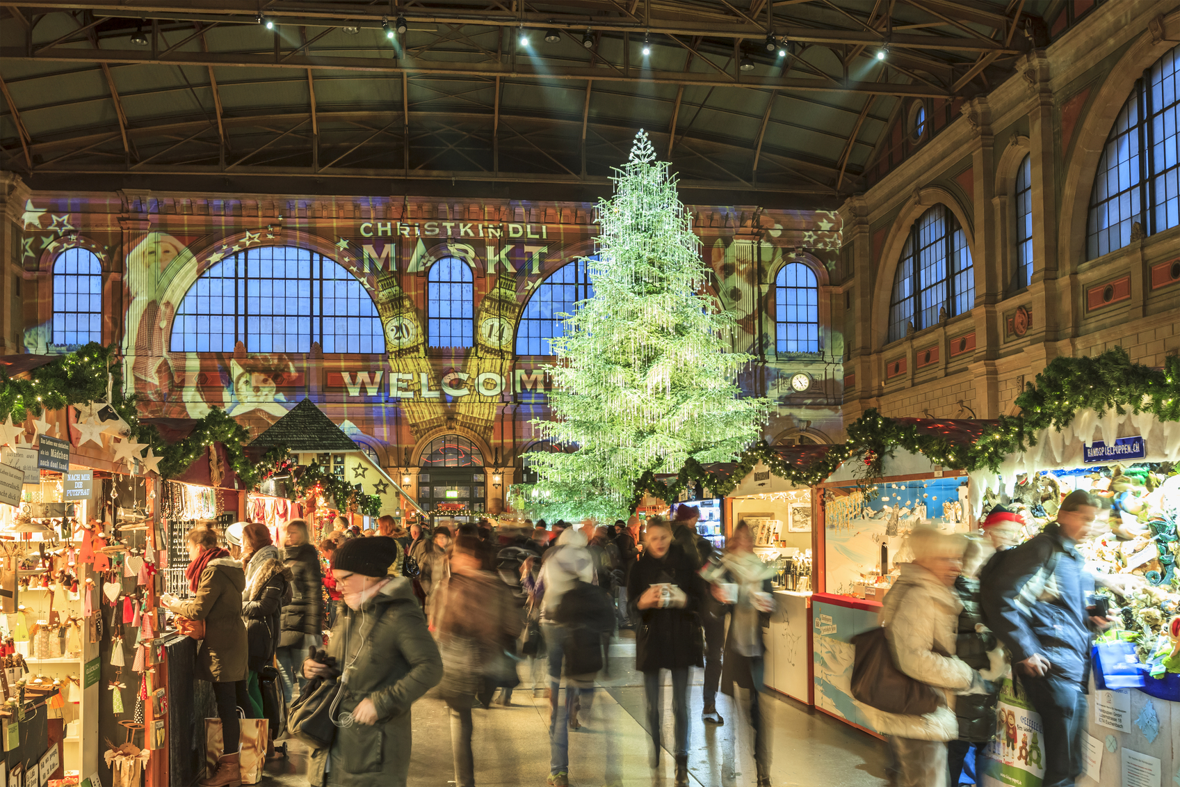 Zurich, Switzerland - December 11, 2014: The Christmas market in the Central Station in Zurich hosts the largest indoor Christmas market in Europe with a large Christmas tree sparkling with over 7,000 Swarovski. People can stroll among stalls of gifts, crafts, sweets and mulled wine.